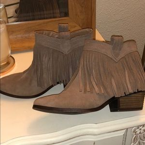 Restricted fringe suede ankle booties